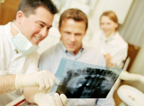 Dentist explaining x-ray to patient